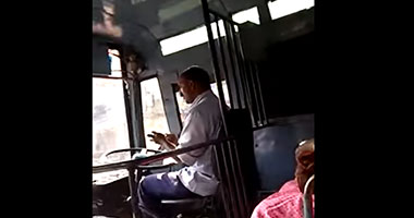 Passenger records video of bus driver repairing his phone while driving