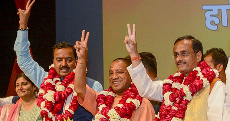 Yogi Adityanath takes over UP reins with 'sabka haath, sabka vikas' as motto